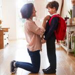 Mom getting child ready for school